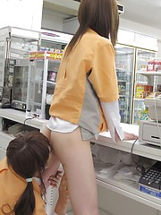 Two shop girls licking each other pussies in the market
