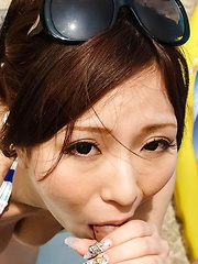AYAMI Asian with colorful bath suit sucks shlong on the beach
